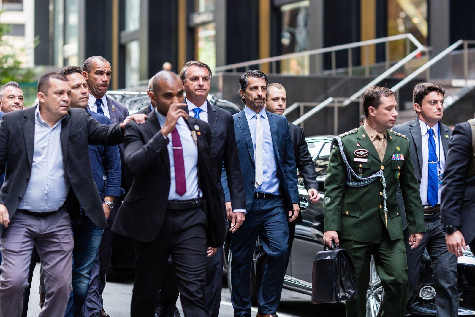Brazil's President Jair Bolsonaro walks outside his hotel in New York