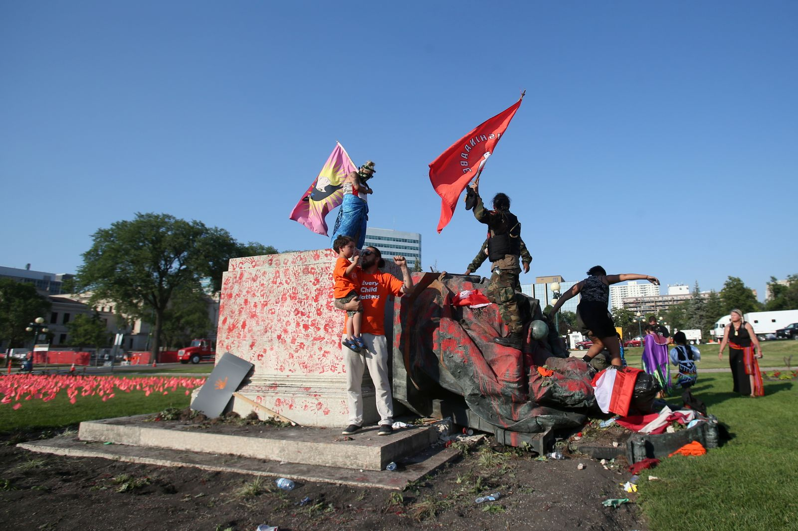 A defaced statue of Queen Victoria lies after being toppled during a rally on Canada Day in Winnipeg