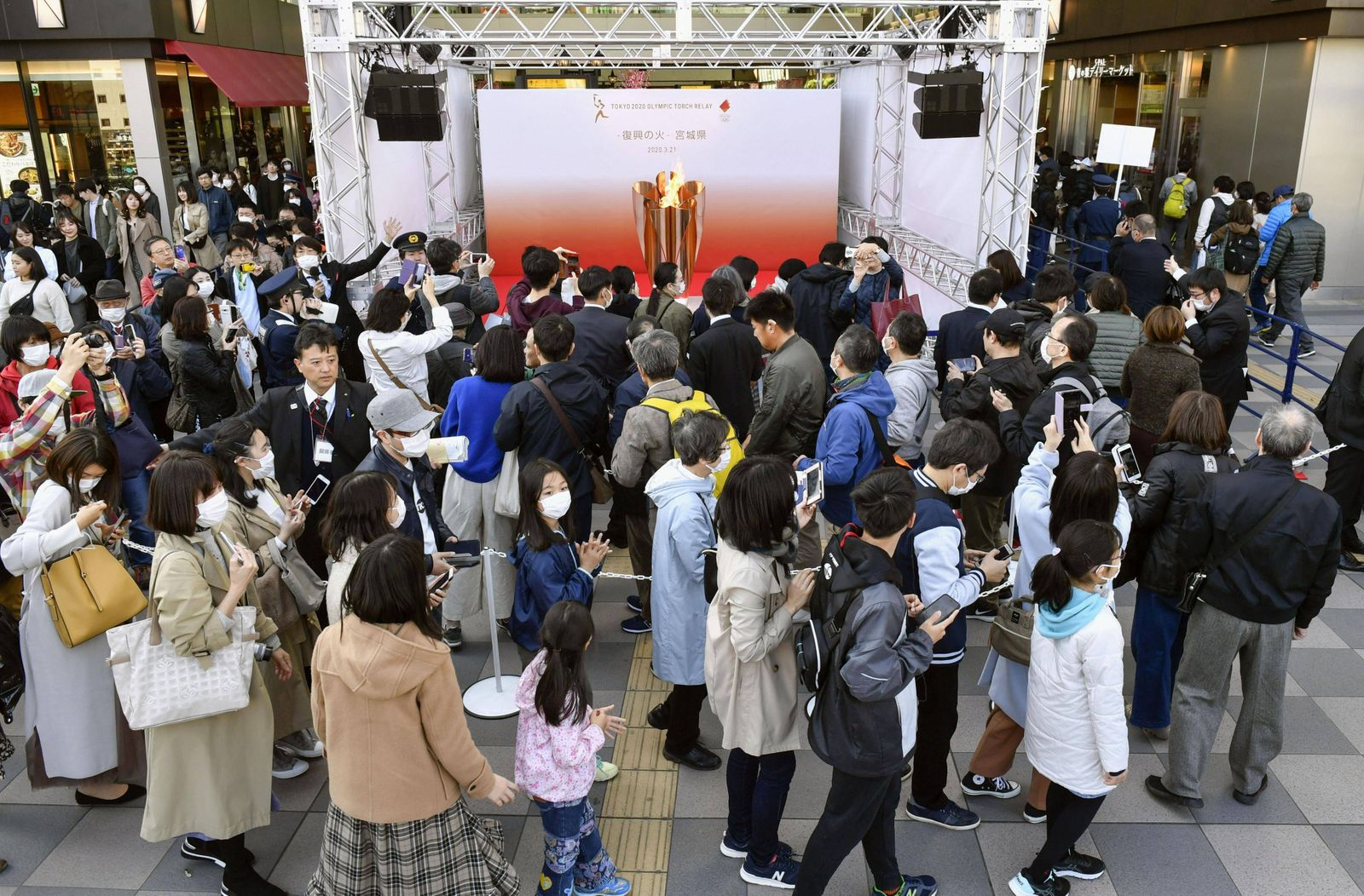 Tour of Olympic flame in Japan The Olympic flame is put on display at JR Sendai Station in Japan s Miyagi Prefecture on
