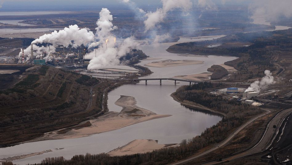 A tar sands extraction plant on the Athabasca River in Alberta, Canada.