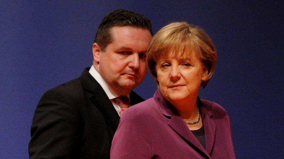 """Ministerpräsident Mappus, Kanzlerin Merkel: """"Unmut über die Kanzlerin"""""""