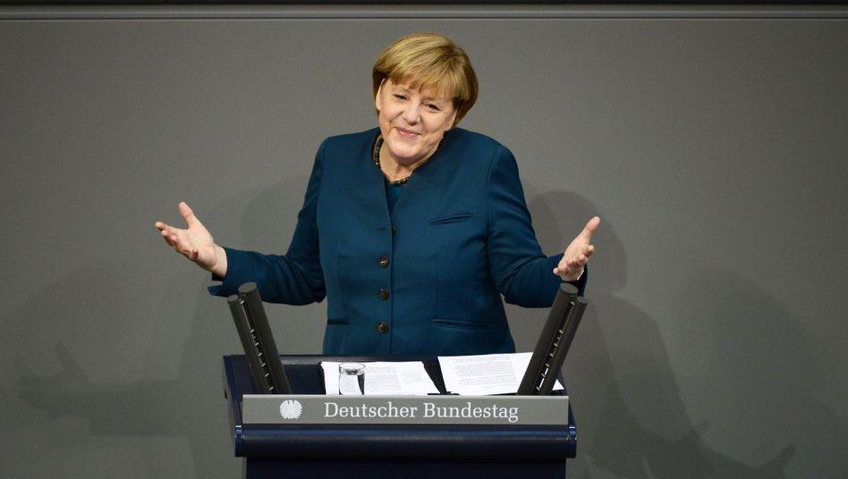 Angela Merkel addresses the Bundestag lower house of parliament on Wednesday.
