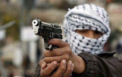 A member of the al-Aqsa Martyr's Brigade at a January protest in the West Bank.