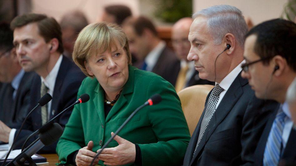 Kanzlerin Merkel, Regierungschef Netanjahu: Drängen auf eine Lösung im Nahost-Konflikt