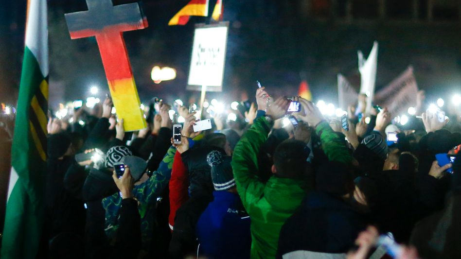 """Members of the loosely organized """"Patriotic Europeans against the Islamization of the West,"""" gather at a major protest in Dresden in eastern Germany on Dec. 8."""