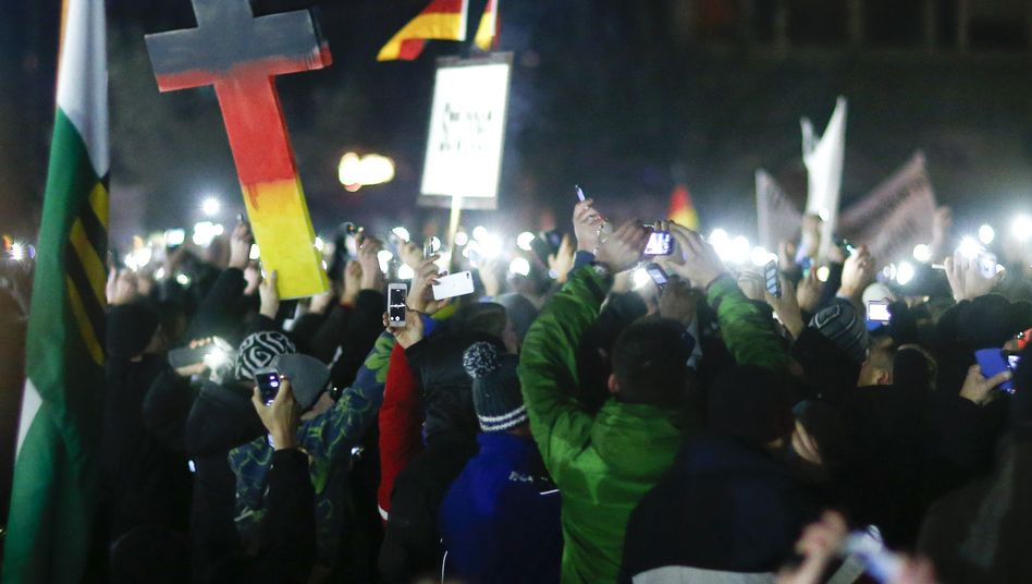 "Members of the loosely organized ""Patriotic Europeans against the Islamization of the West,"" gather at a major protest in Dresden in eastern Germany on Dec. 8."