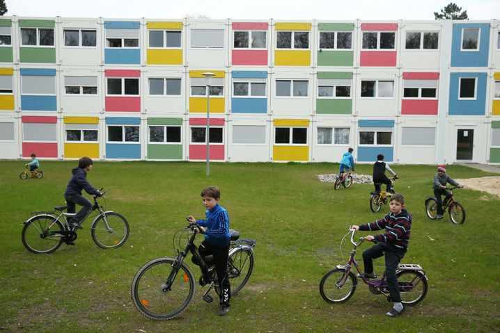 Children play at a container settlement shelter for refugees in Berlin.