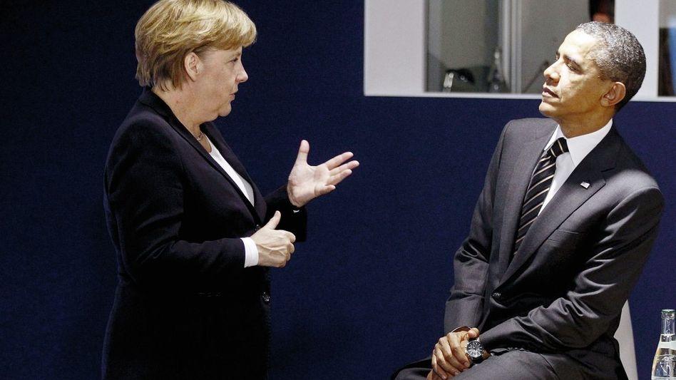 Kanzlerin Merkel, US-Präsident Obama: Bedrohung für die globale Wirtschaft