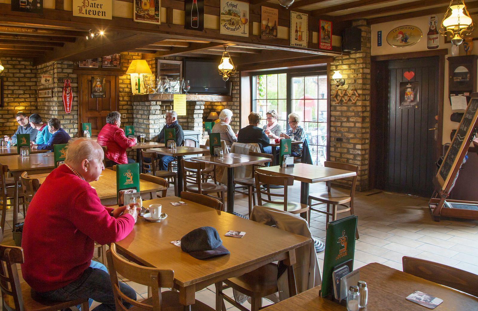 Elderly customers in the Belgian cafe De Zandvlooi in the Flemish village Kruishoutem.