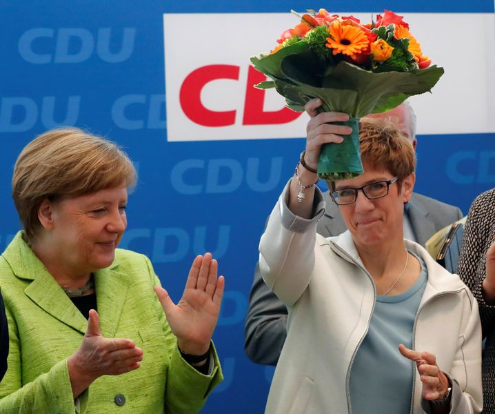 German Chancellor Angela Merkel congratulating Saarland Governor Annegret Kramp-Karrenbauer after state elections last March.