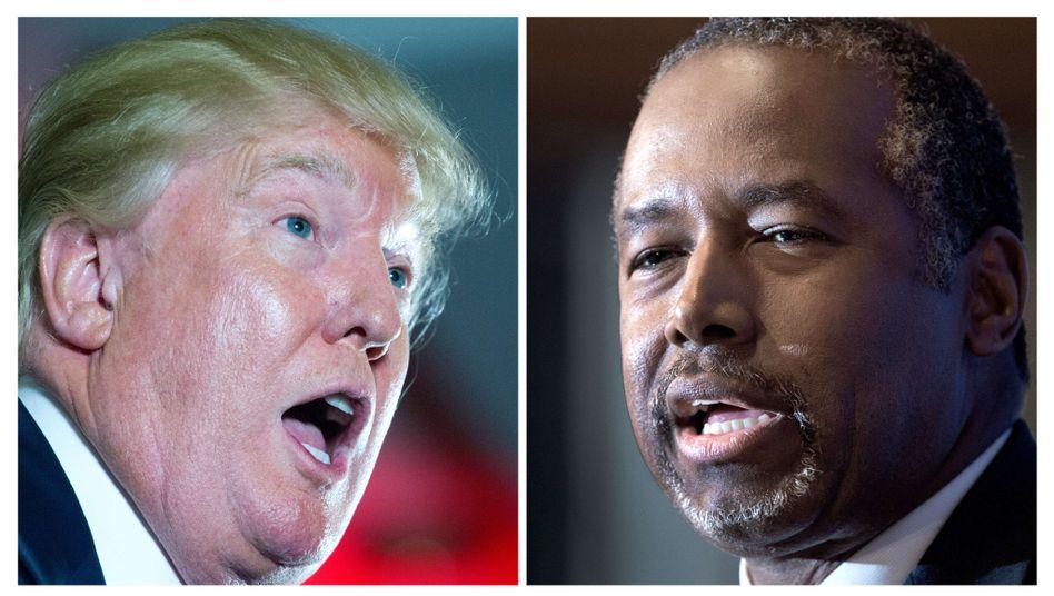 Trump (l.) und Carson: Liegen in Umfragen vorn - und werden deshalb beschützt