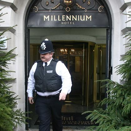 A policeman walks out of the Millennium Hotel in Mayfair, London.