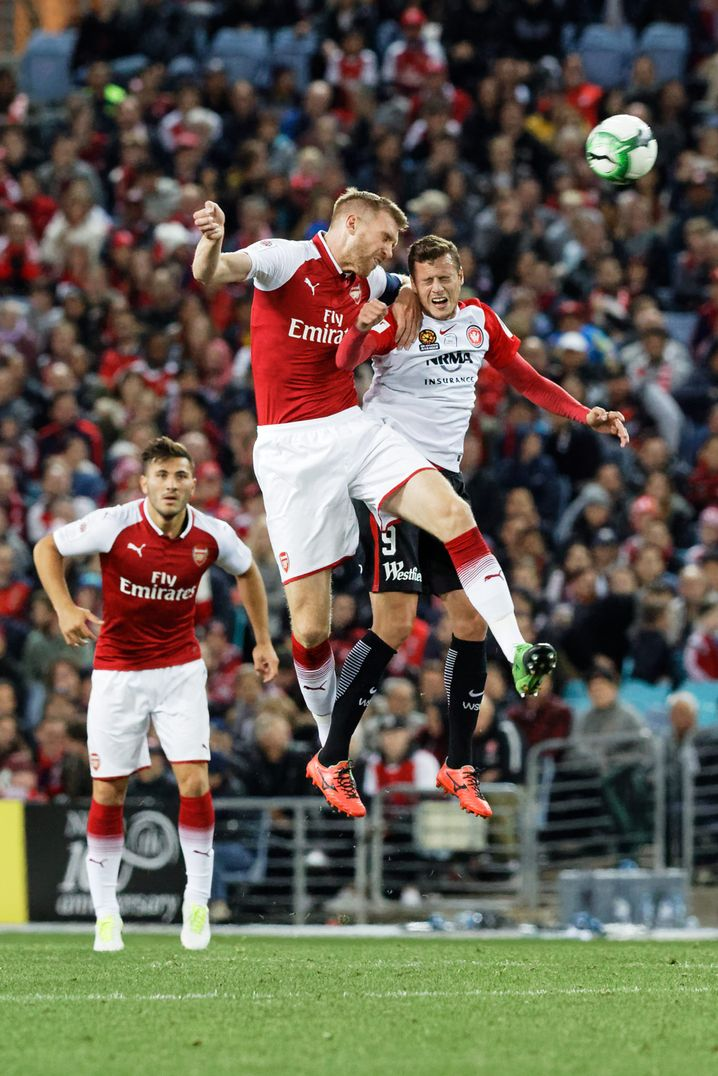 Arsenal player Per Mertesacker shows off his skills in the air.