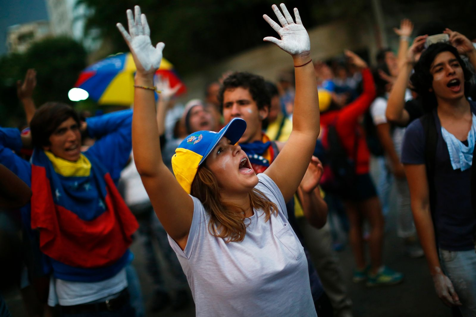 Students shout against the National Guards during a demonstration outside Voluntad Popular headquarters in Caracas