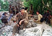 Members of thePeople's Liberation Army of Kurdistan (ARGK) who are the military wing of the Kurdistan Workers Party (PKK)in mountain hideout in northern Iraq near the Turkish border.