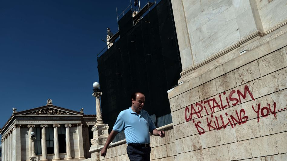 Graffiti in Athens: The Greek government is expected to have a budget shortfall of €11 billion over the next two years.