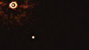 Astronomen fotografieren junges Planetensystem