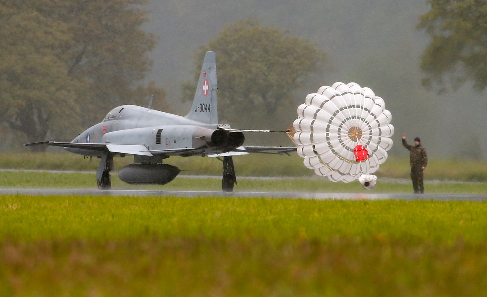 A Swiss F-5 Tiger fighter jet lands at the air base of the Swiss air force in Buochs