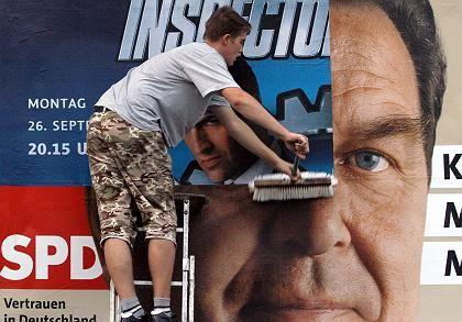 Wahlplakate werden überklebt: Schröder zeigt Kompromissbereitschaft