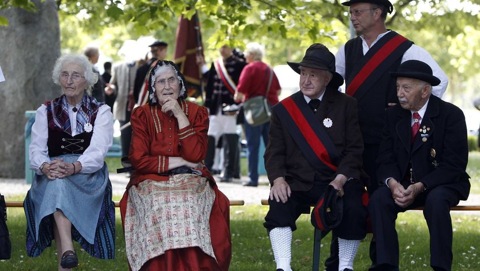 People in traditional dress at the 62nd annual Sudeten German meeting in Augsburg.