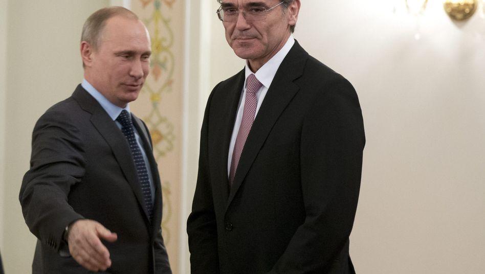 Putin (links), Siemens-Chef Kaeser: Schelte vom SPD-Chef