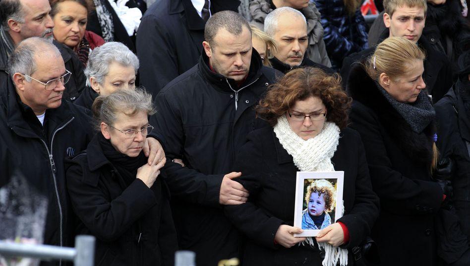 Stille Trauer: Angehörige von Opfern des Anschlags von Lüttich gedenken der Toten