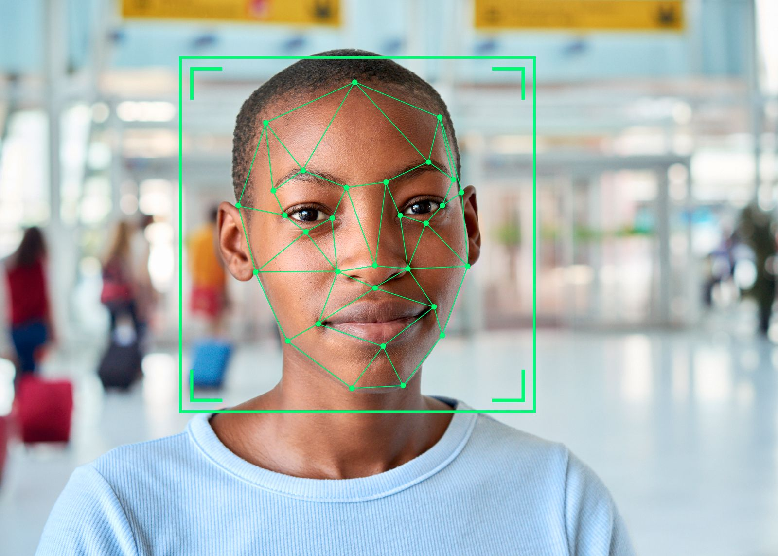 Face recognition markings on the face of a short-haired young woman.