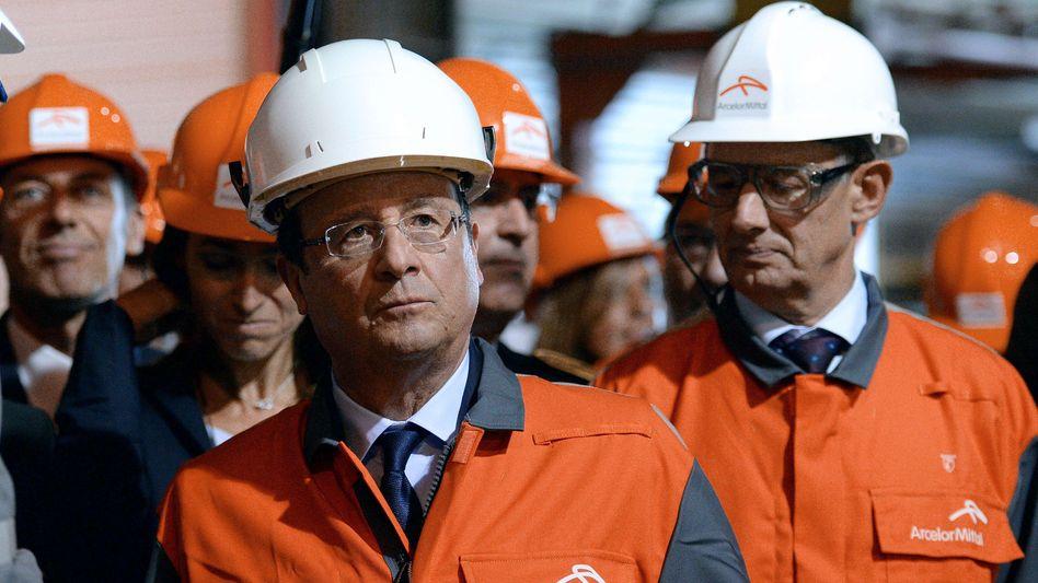 Frankreichs Präsident Hollande (im Stahlwerk Florange): Saftige Strafen