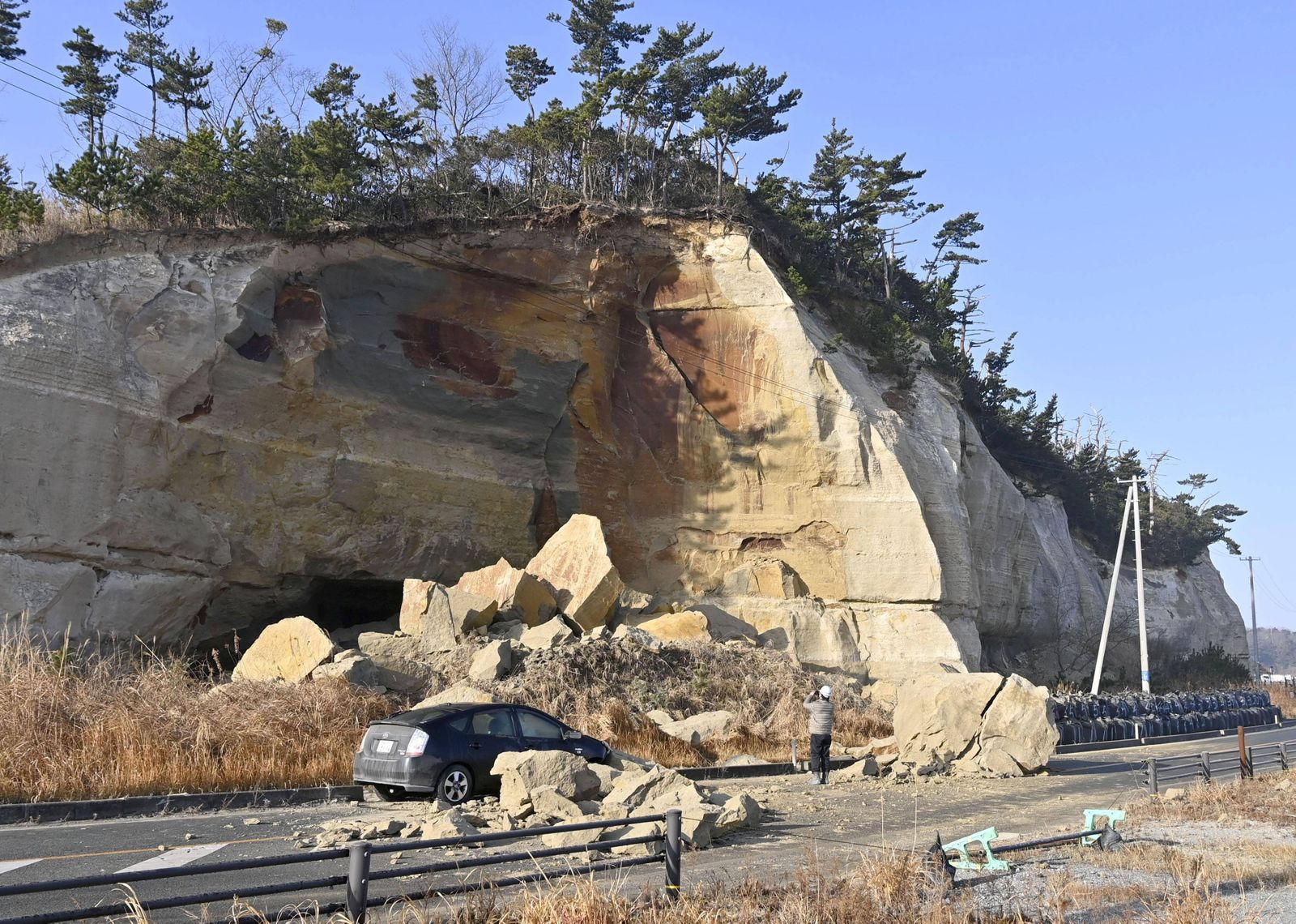 Strong quake in northeastern Japan Fallen rocks are seen on a road in Soma, Fukushima Prefecture, on Feb. 14, 2021, aft