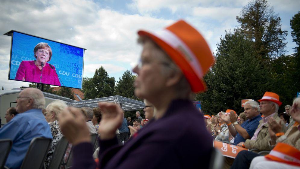 Photo Gallery: Euro Crisis Throws Merkel Campaign Off Balance