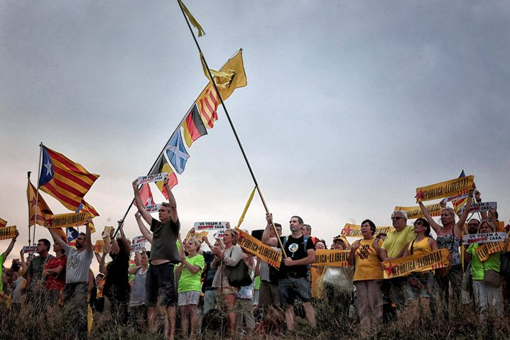 Several people protest outside Lledoners Prison protest for the release of imprisoned Catalan pro-independence politicians in a village near Barcelona.