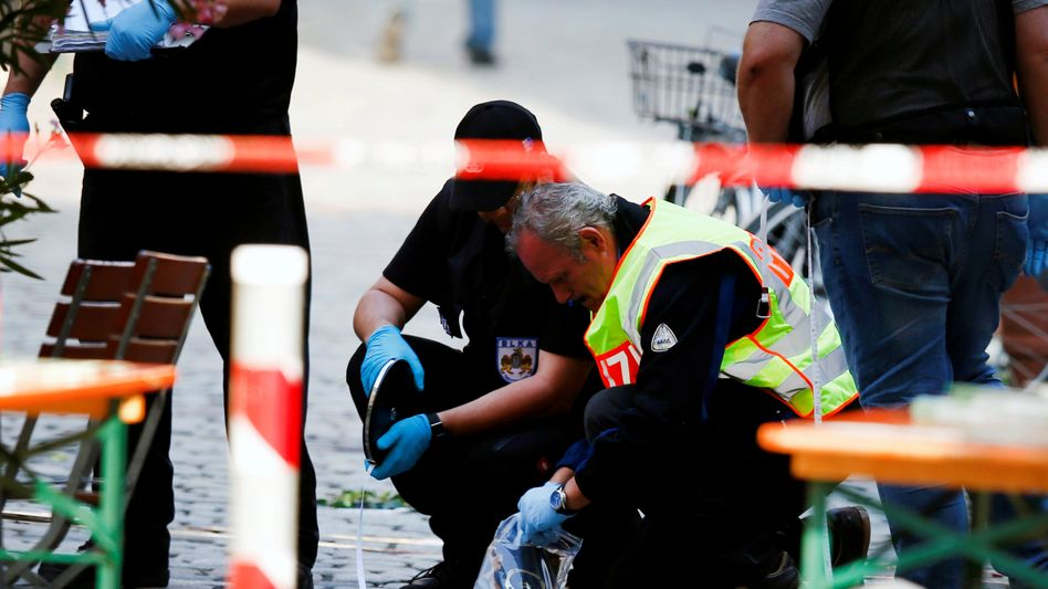Investigators at the site of the July 24 attack in Ansbach, Germany