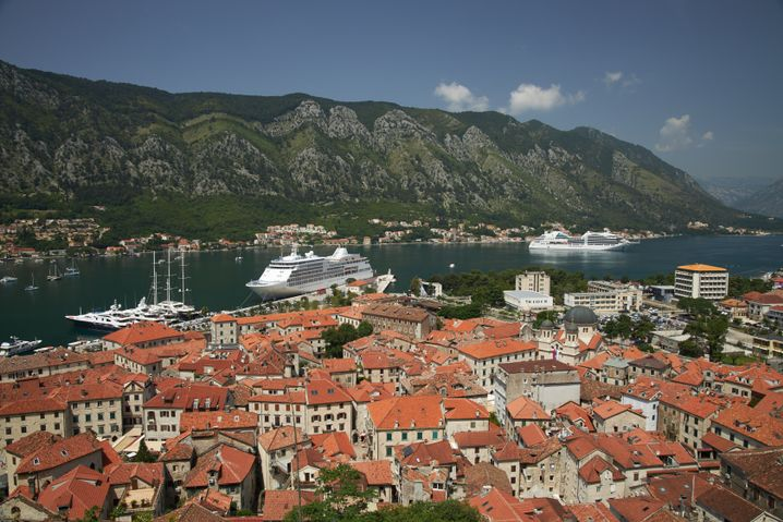 Cruise ships approach the city of Kotor.
