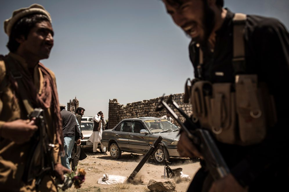 Soldiers with the Popular Uprising, a government-aligned militia fighting against the Taliban near Achin District.