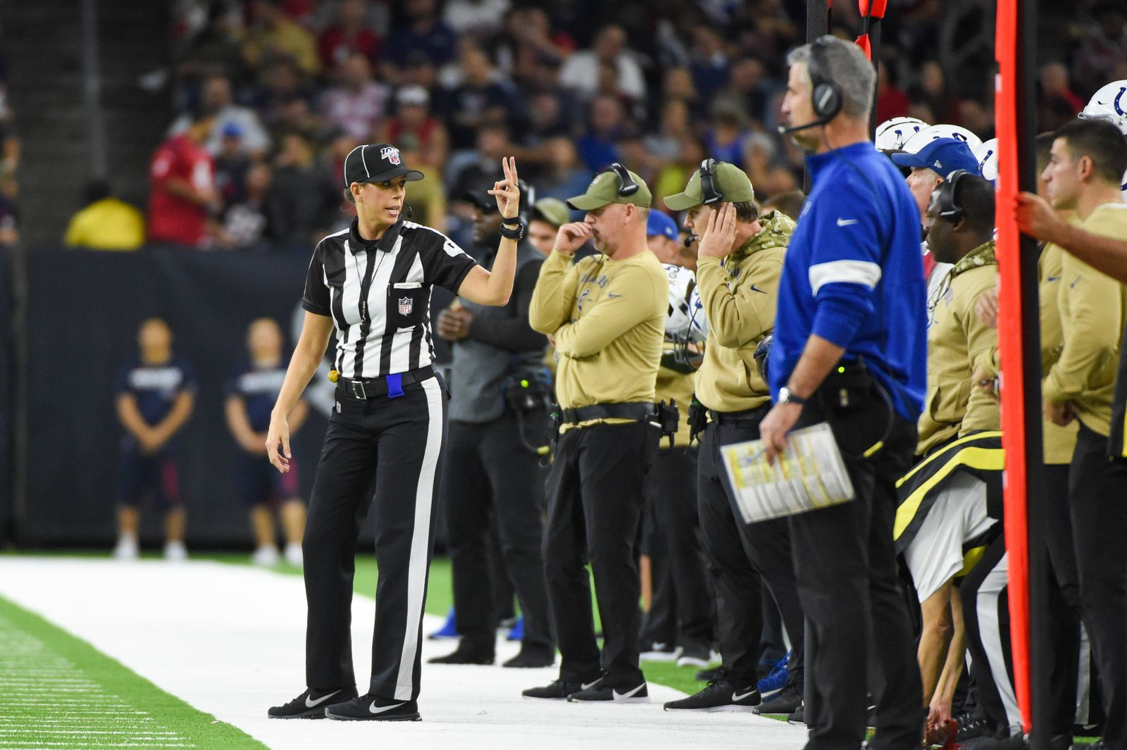 HOUSTON, TX - NOVEMBER 21: Down judge Sarah Thomas (53) talks to the Colts bench during first half action during the fo