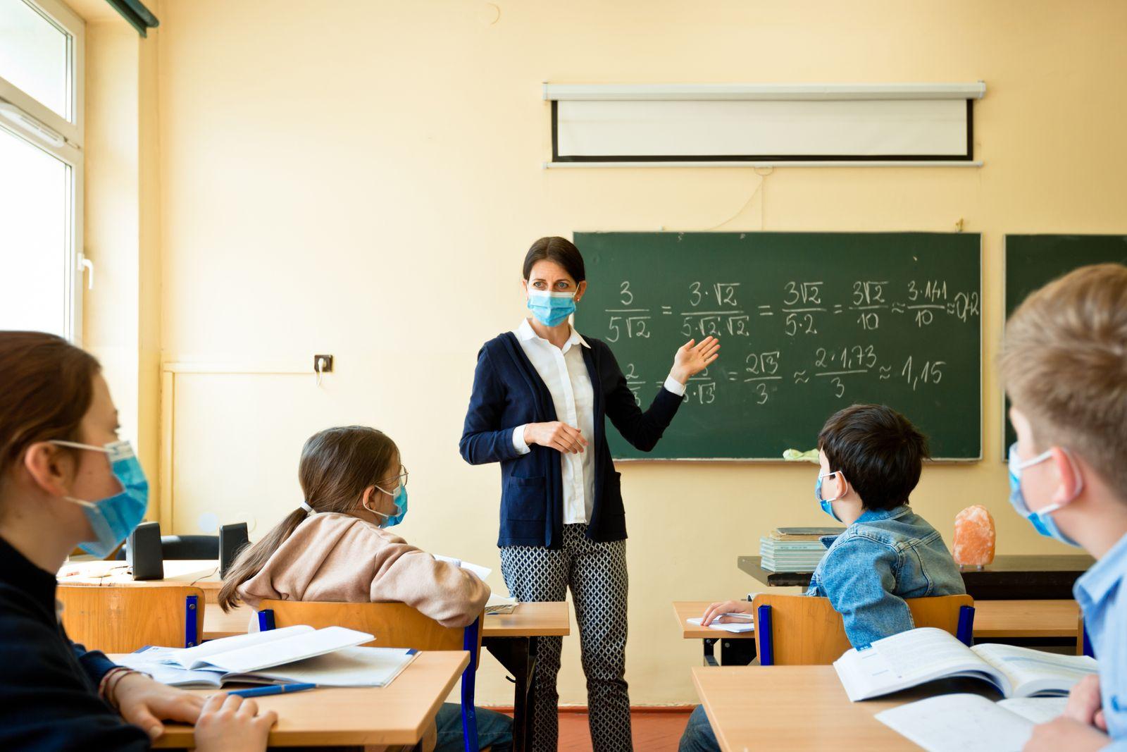 Covid-19. A teacher teaches mathematics