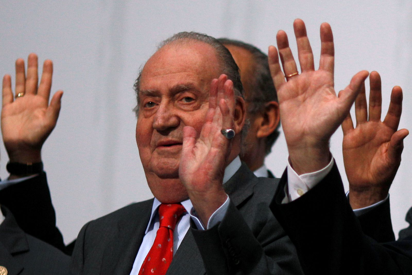 FILE PHOTO: Spanish King Juan Carlos waves during a group photo with Ibero-American leaders during the Ibero-American Summit in Cadiz