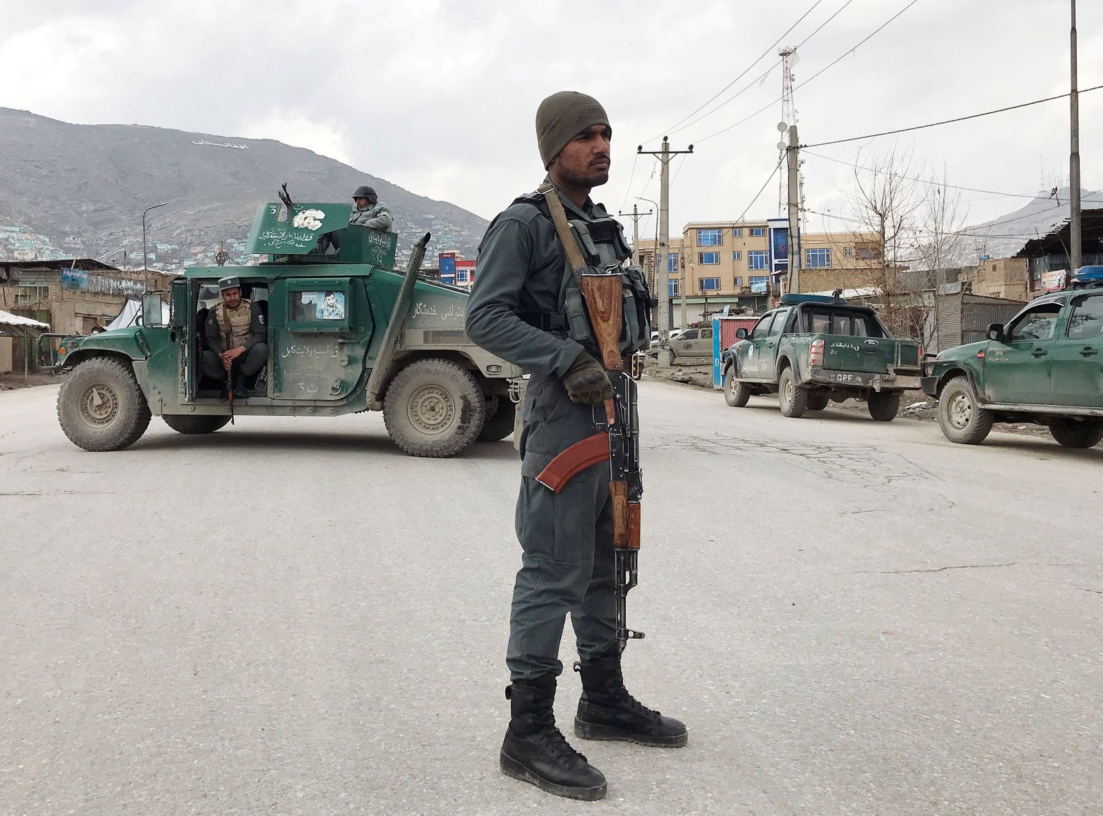 An Afghan policeman stands guard near the site of an attack in Kabul,