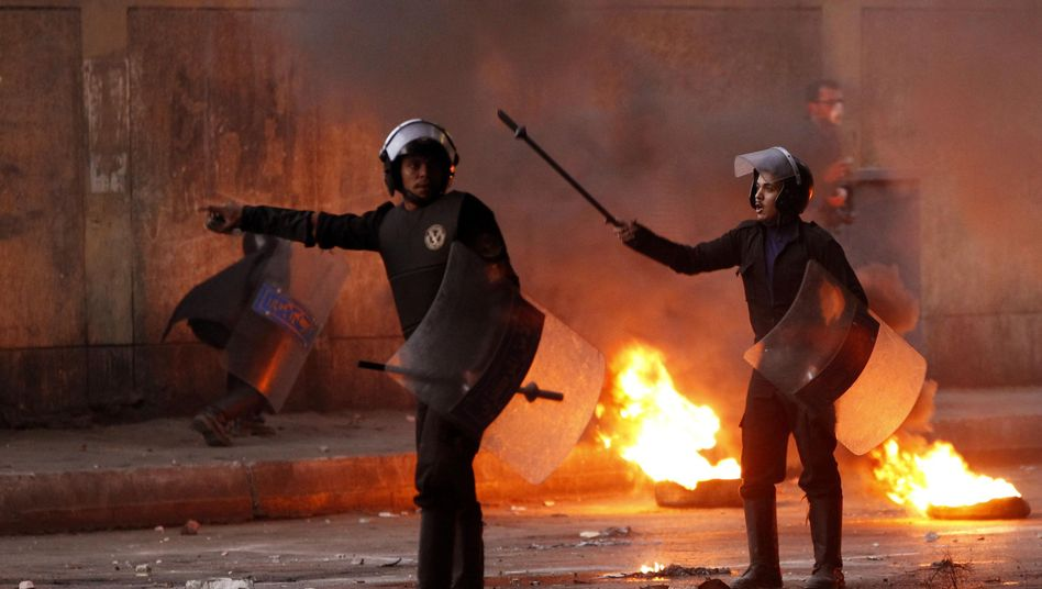 Riot police in Cairo (Jan. 26 photo): Israel is afraid of regime change in Egypt.