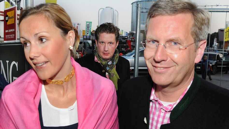 Then Lower Saxony Governor Christian Wulff and his wife Bettina and film financier David Groenewold (center) attended Oktoberfest together in 2008.