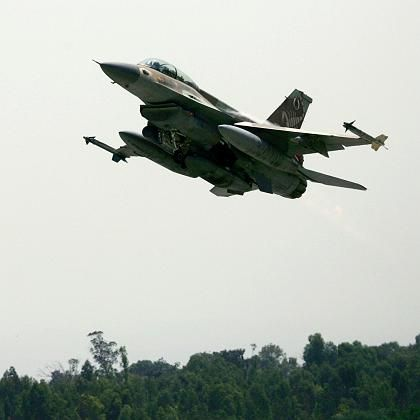 A British newspaper reported Sunday that Israel has drafted plans to strike targets in Iran with low-yield nuclear weapons. In this July 2006 file photo, an Israeli F-16 warplane takes off for a mission from an air force base in southern Israel.