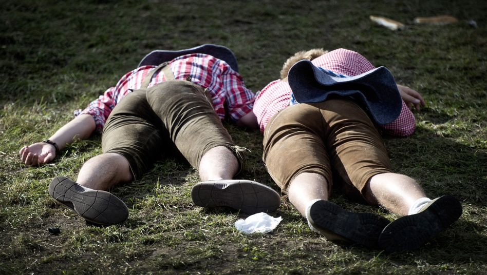 Oktoberfest visitors taking a well-earned nap.