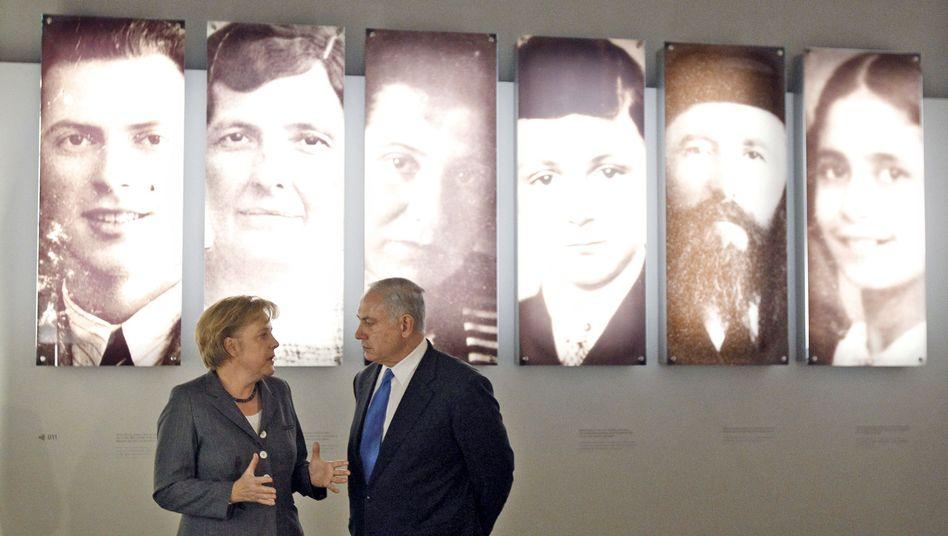 German Chanceloor Angela Merkel and Israeli Prime Minister Benjamin Netanyahu during a visit to the Holocaust Memorial in Berlin last year.