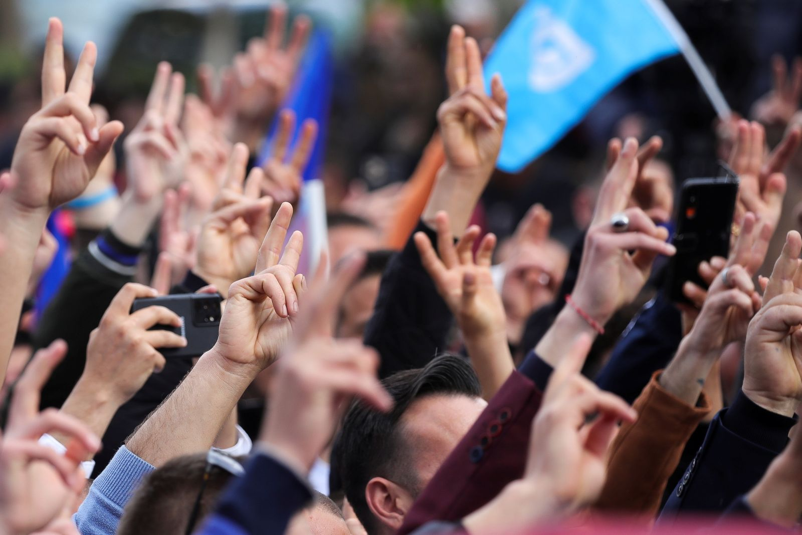 People attend an election rally held by Albania's opposition Democratic Party leader Lulzim Basha in Berat