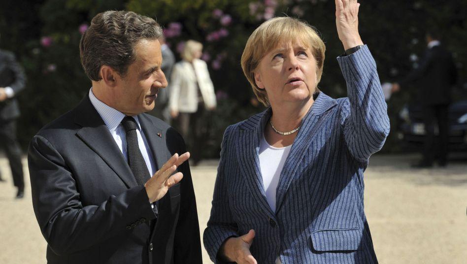 """Politiker Sarkozy, Merkel in Paris: """"Im Schatten"""" der Kanzlerin?"""