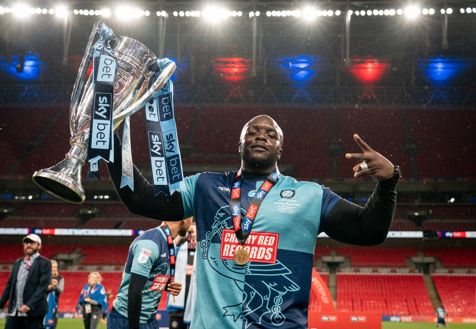 Adebayo Akinfenwa of Wycombe Wanderers lifts the winning trophy during the Sky Bet League 1 play-off final match betwee