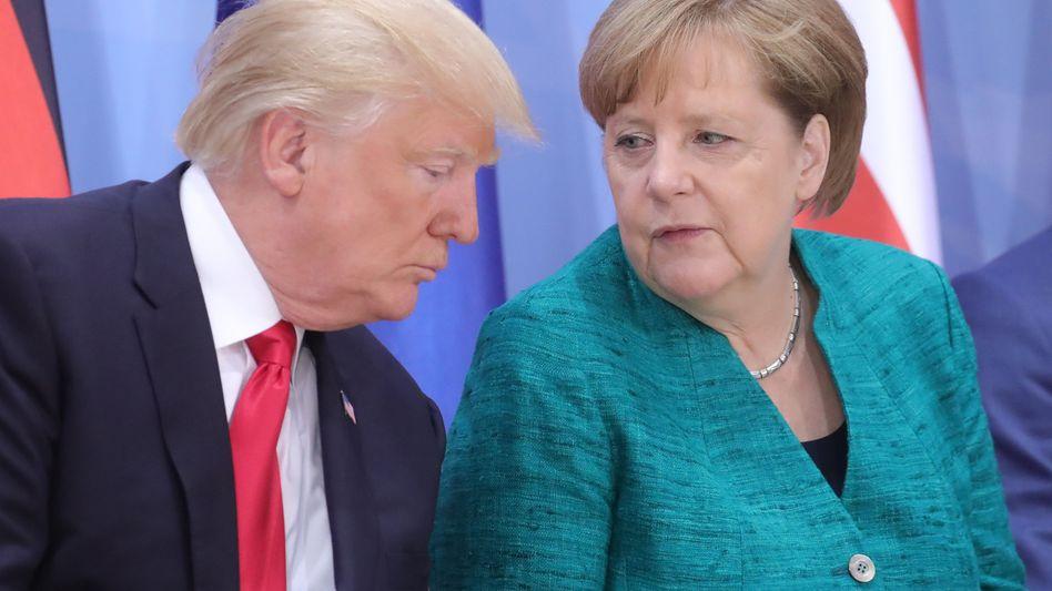 Donald Trump, Angela Merkel (beim G20-Gipfel in Hamburg)