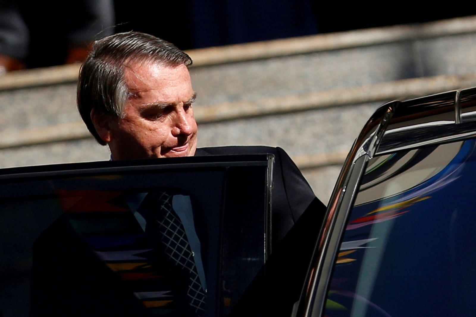 FILE PHOTO: Brazil's President Jair Bolsonaro walks from Catholic church in Brasilia