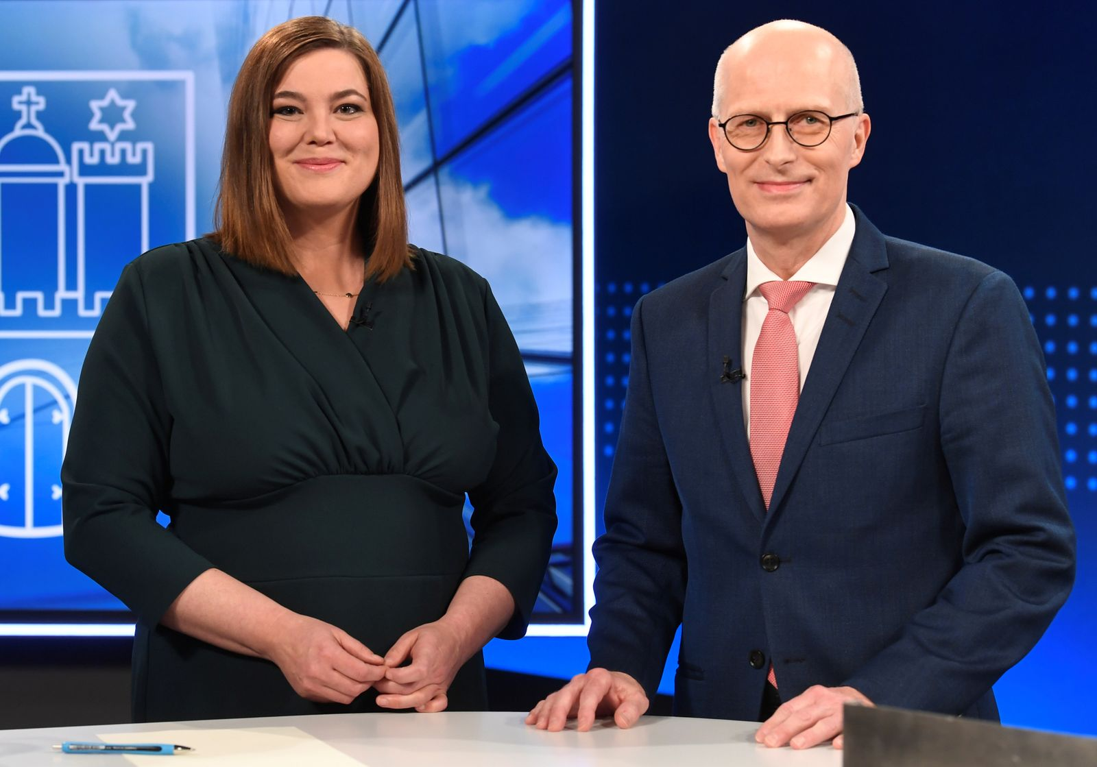Top candidates, mayor of Hamburg Peter Tschentscher of the Social Democrats (SPD) and Katharina Fegebank of the Greens, pose for the media before a TV debate in Hamburg