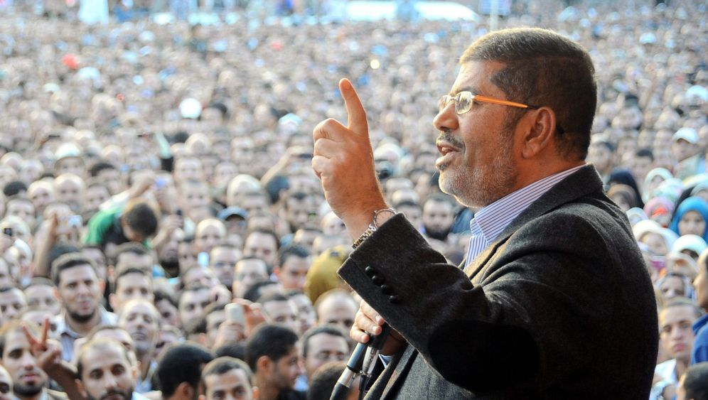 Picture Gallery: Does Morsi Speak with Two Tongues?